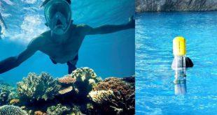 Schwimmer mit Zenoplige Schnorchelset im Meer